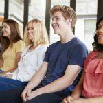 group-of-high-school-students-listening-to-present-WVJRM4U